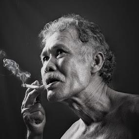 Cigarette by Iwan Mochammad - People Portraits of Men