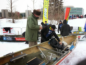 Photo: Our boat fixer guy came down to watch the time trials and smile upon his handy work