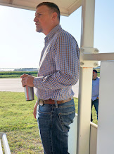 Photo: Daran Rudnick, Asst. Professor, describes the Testing Ag Performance Solutions competition, in which various state farmers compete to select the best combination of inputs (water, fertilizer, etc.) to produce the most cost-effective crop yield.