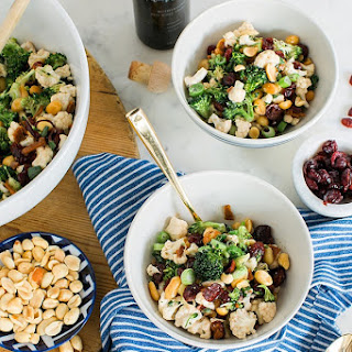 Vegan Broccoli Salad with Cauliflower, Green Onions, Cranberries & Peanuts.
