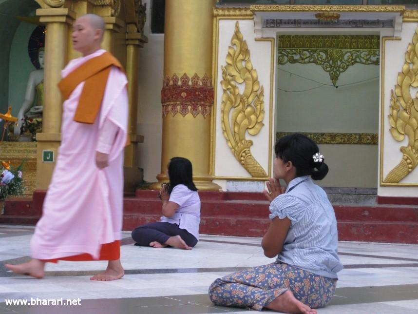 Praying at the Shwedagon Pagoda in Yangon, Myanmar