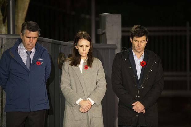 rime Minister Jacinda Ardern stands at dawn on the driveway of Premier House wit