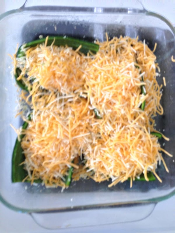 Cover chilis with grated cheese. I used pre-shredded mexican blend.