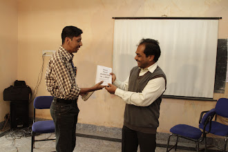 Photo: Gifting Dr. Mahapatra a few publications from TISA as a token of appreciation...