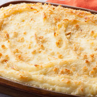 Baked Mashed Potatoes with Parmesan Cheese and Bread Crumbs.