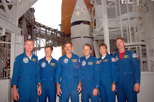 The STS-115 crew pauses for a photo during training on Launch Pad 39B.