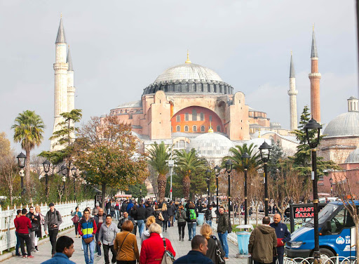 Hagia-Sophia-seen-from-the-Blue-Mosque.jpg - Visitors move between Hagia Sophia and the Blue Mosque in Istanbul, Turkey.