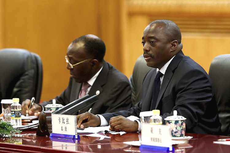 Joseph Kabila, right . Picture: REUTERS/LINTAO ZHANG