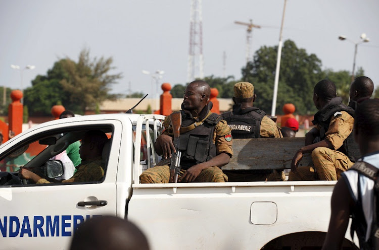 Paramilitary police drive by anti-coup protesters in Ouagadougou, Burkina Faso. File Picture: REUTERS