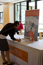 Photo: An attendee of the 2011 Nonprofit Management Institution signing up for her free weekly SSIR e-newsletter.