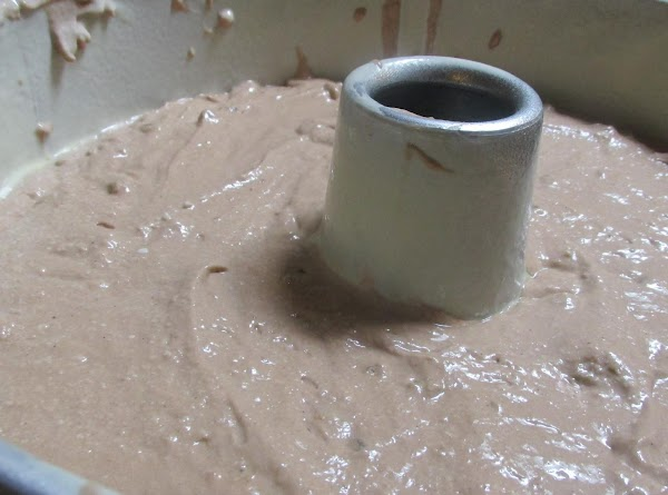 Pour batter evenly into cake pan, then smooth out the top with the back...