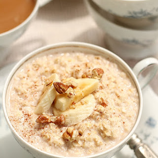 Creamy Instant Oatmeal Topped with Bananas and Pecans.