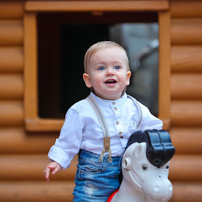 child playing by Costi Manolache - Babies & Children Child Portraits ( horse toy, blue jeans, toys, child portraits, blue eyes, children photography )