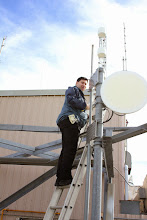 Photo: William VE4VR preparing to install the HSMM antennas