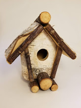 Photo: Birch wood bird house Donated by Rick & Terry Colella