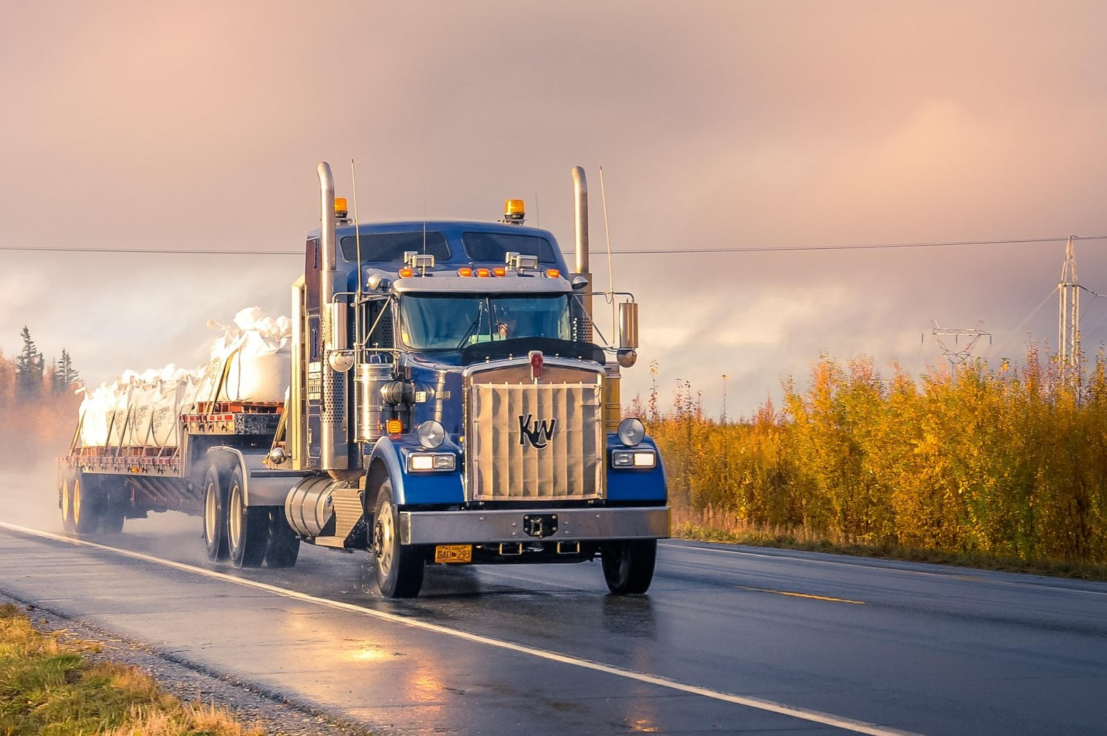 A picture containing sky, road, outdoor, truck  Description automatically generated