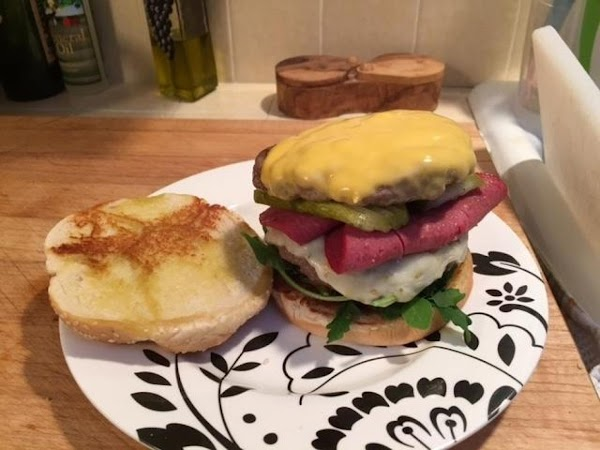 Split the buns, spread a little olive oil on each half and toast for...
