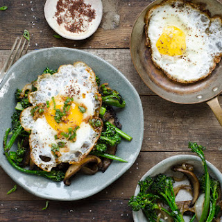 Sautéed Portabella Mushrooms And Broccolini With Fried Egg
