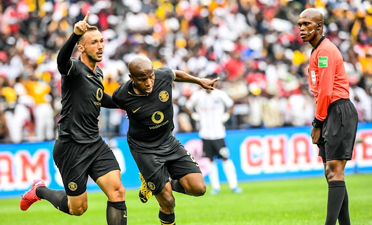 Lebogang Manyama of Kaizer Chiefs celebrates with teammate Samir Nurkovic of Kaizer Chiefs during the Absa Premiership match between Orlando Pirates and Kaizer Chiefs at FNB Stadium on February 29, 2020 in Johannesburg, South Africa.