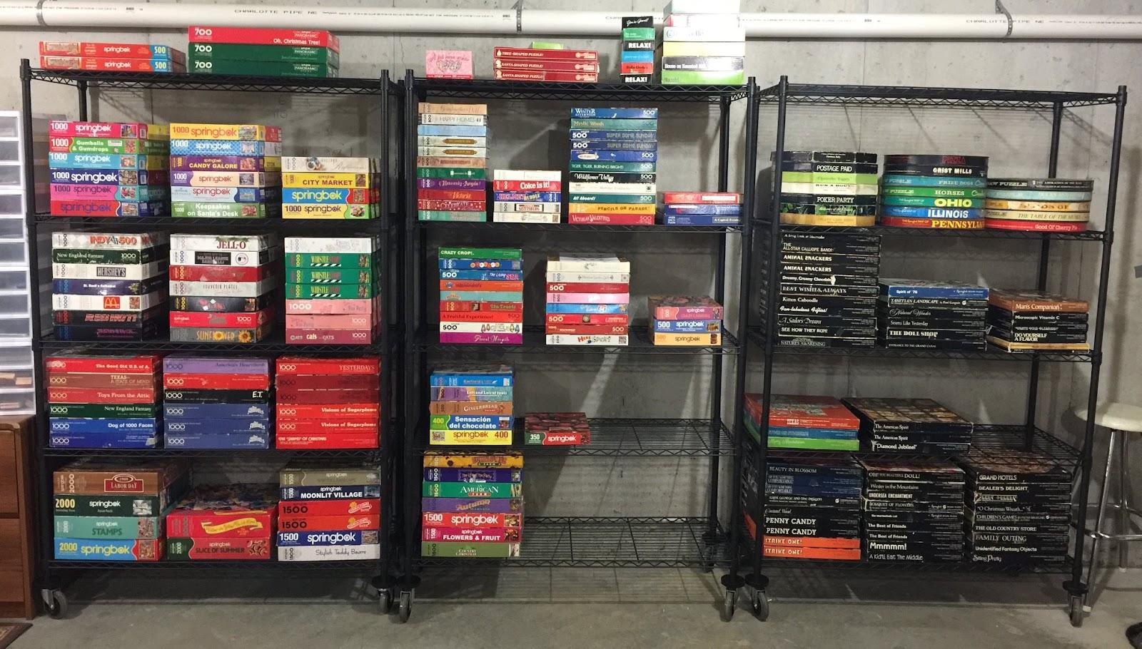 Planchak's large puzzle collection on shelves.