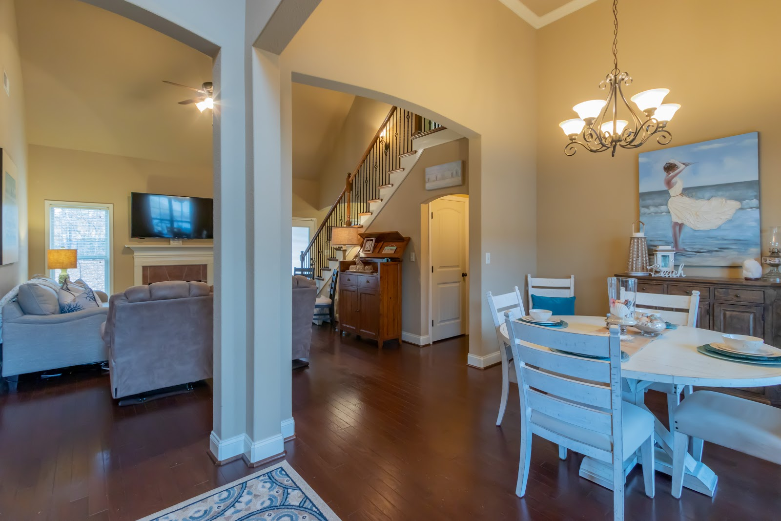 Plenty of light is needed at the entryway. Clearly define areas when staging an open concept home.