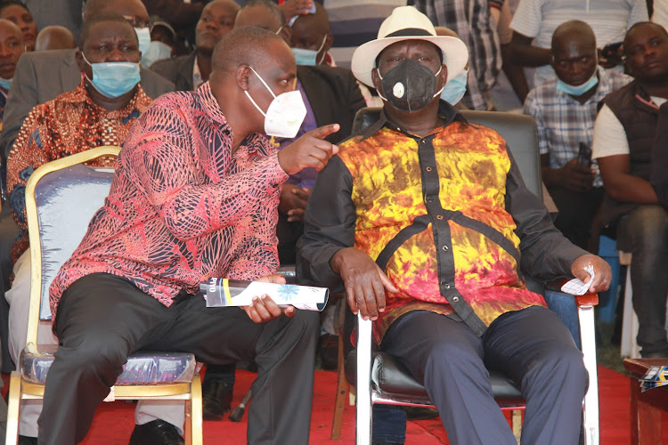 Minority leader in the National Assembly John Mbadi and ODM leader Raila Odinga at the burial of Zachary Origa at Ratanga village in Ndhiwa constituency on February 2021