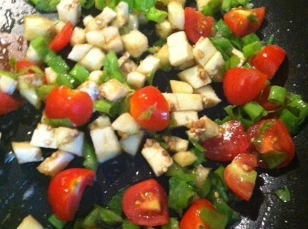 Chop Eggplant in to small pieces. Chop onion,Scallions,and Bell pepper in to small fine...